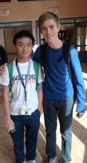 Kenny Brill '17 walks in the halls with Wan Jie