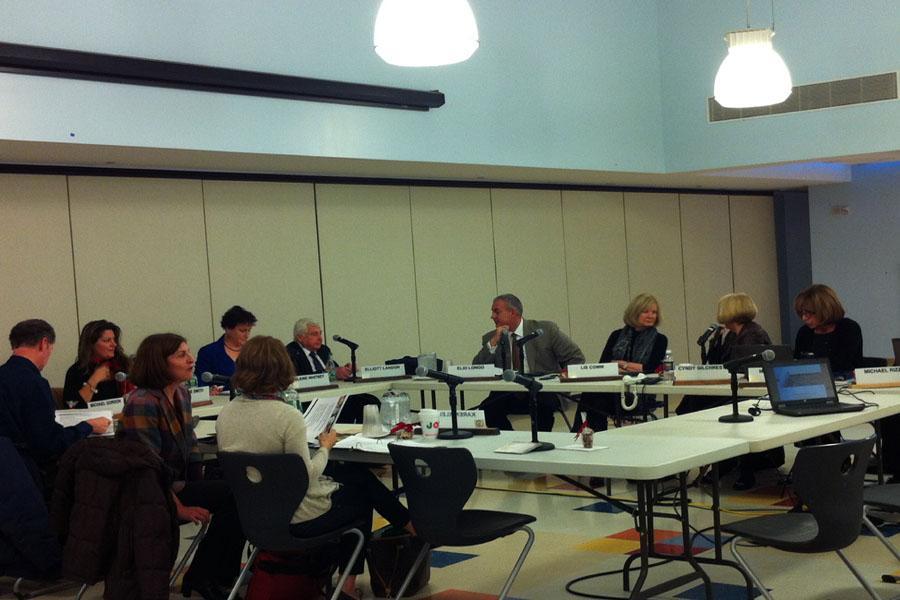 The BOE members assemble before the meeting begins.