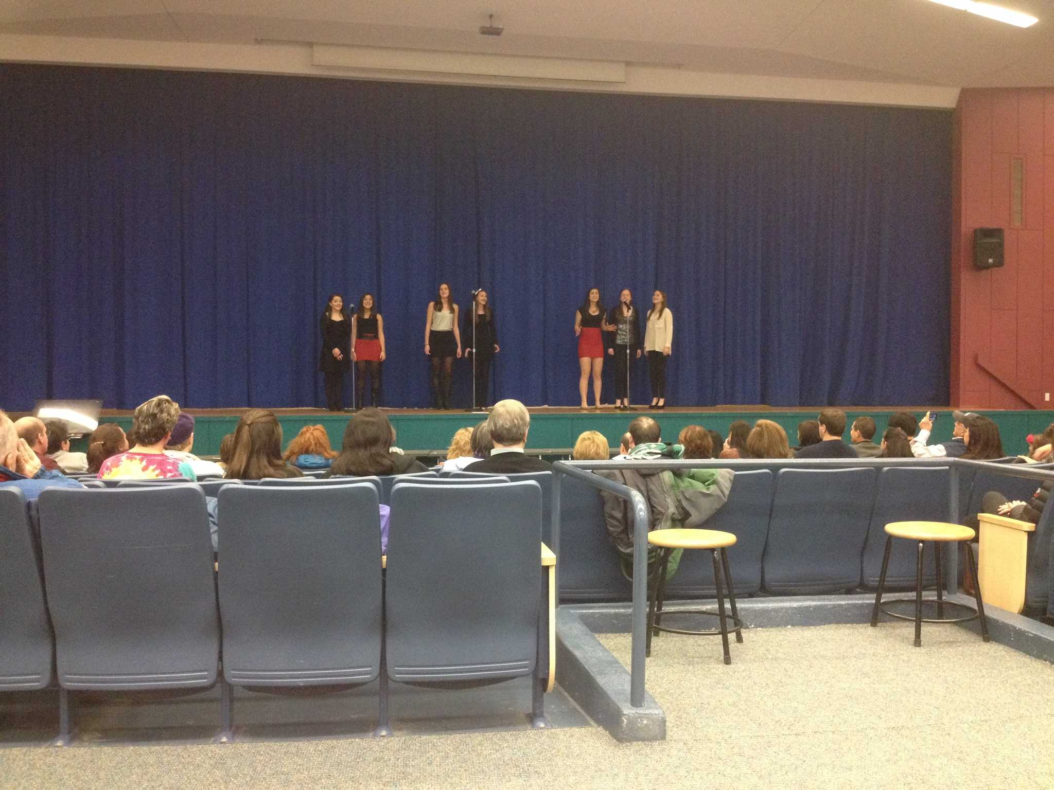 The girls of the group perform the song She's In Love from the musical