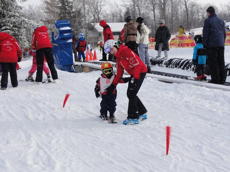 Emily Duranko guides and glides 4-year-old Remy for the Little Cub program at Stratton Mountain on Jan. 19.