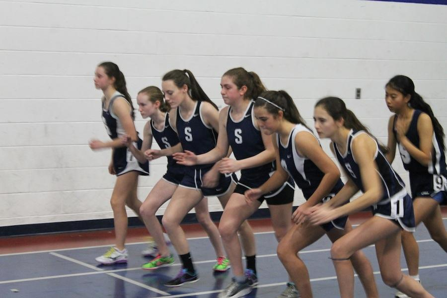 Members of the girls' indoor track team prepare for the 1000m run.