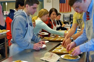 Culinary students bake cookies during class, just as Gans' Connections group does.