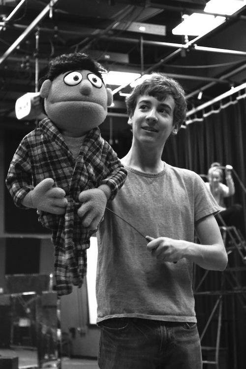 Will Haskell '14, playing the character Princeton in the Staples' production, practices his puppeteering with professional puppeteers Pam Arciero and Rick Lyon.