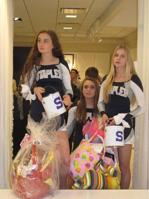 Ayden Schattman '16, Jessy Nelson '16 and Kelsey Gladstone '17 prepare to go on stage with raffle items.