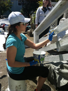 Staples students paint a house in Oakland, CA while on a Temple Israel Senior Youth community service trip.