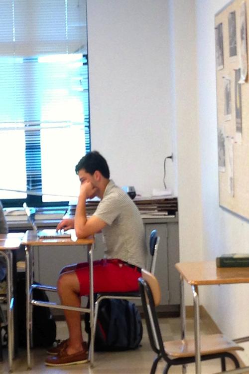 Jack+Greenwald+%2714+scrolls+through+Facebook+during+class.