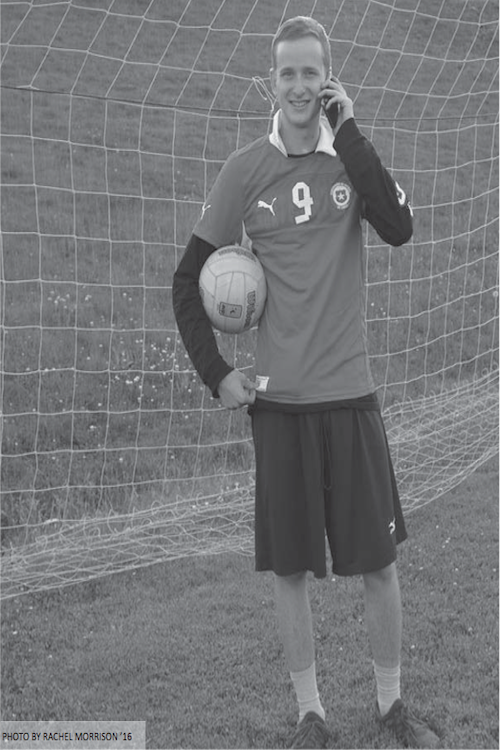 Ben+Cion+%E2%80%9914+poses+on+Loeffler+Field+while+combining+his+love+for+soccer+and+social+media.+His+twitter+%40StaplesSoccer1+has+160+followers+waiting+in+anticipation+to+hear+his+game+commentry+and+recap.