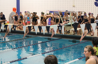Staples Girls' swim and dive sets records in season opener