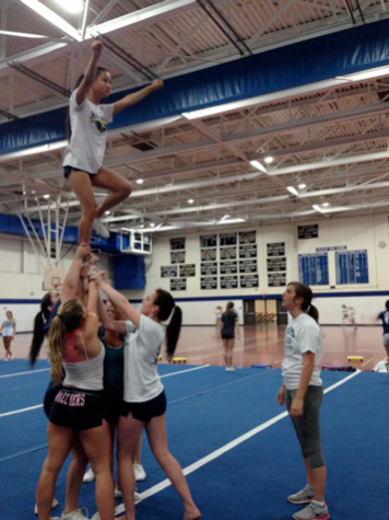Harding brings new rush of spirit to Staples cheer team