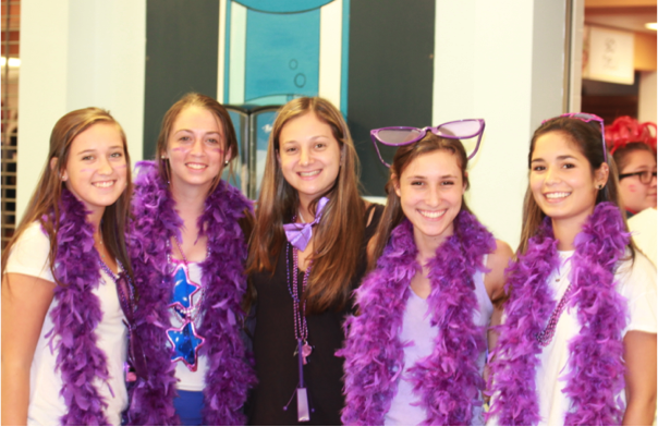 Boa+feathers+fill+the+halls+as+the+junior+girls+get+in+the+spirit+before+pep+rally+and+homecoming.+Julia+Lindwall%2C+Mackenzie+Wood%2C+Liv+Smith%2C+Sarah+Bookbinder+and+Carly+Crossfield+all+class+of+16.+