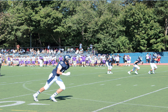 """Ryan Fitton '17 towers over the opposition with his 6' 5"""" and 215 lb. frame in the Sept. 27 game against Westhill.  During this game he had a 52 yard punt"""