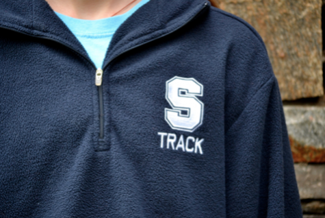 A student throws on her comfy ASF track fleece after a meet.