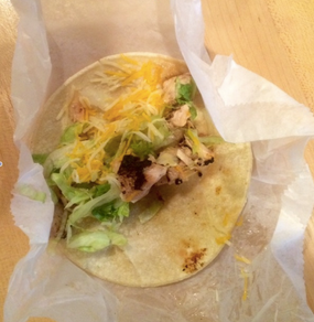 This delicious soft shell taco is stuffed with chicken, lettuce, and cheese.