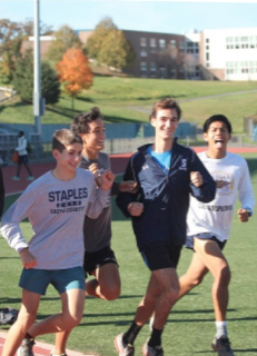 Running on the track (from left to right) Connor Teran '17, Zak Ahmad '17, James Lewis '16 and Luis Cruz '15 work on their times during varsity track's practice. The team placed second in the recent FCIAC competition.