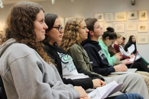 AP Environmental Science students Julie Bender '15, Olivia Jones '15, Emily Wolfe '15 and August Densby '15 listen intently to Eric Starbuck's information on the history of Ebola.
