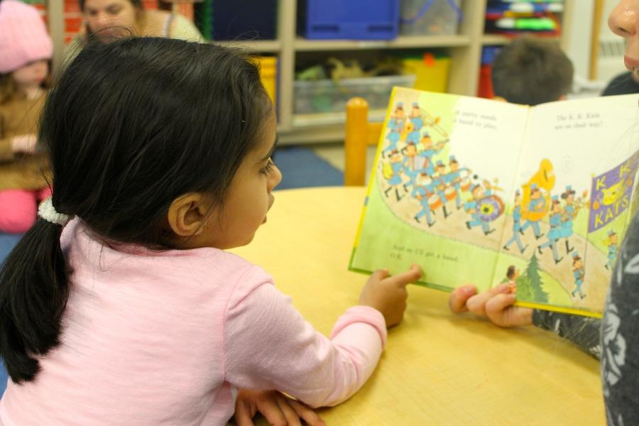 Bella Purcell's buddy listens intently to her read Dr. Suess's