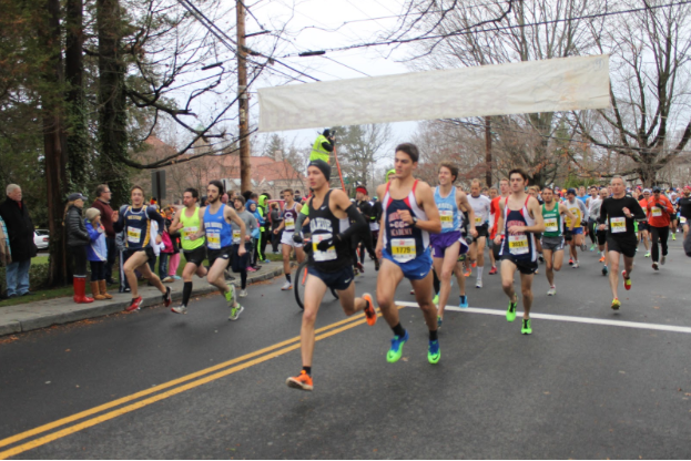 At 8:15 AM the race was on. Once the gun was shot, these runners sprung into action and led the race until the finish.