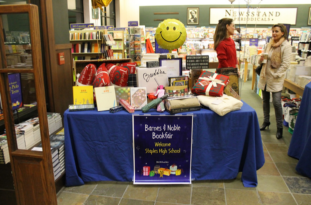 In the entrance of Barnes and Noble, books, gifts, and other products welcome customers.
