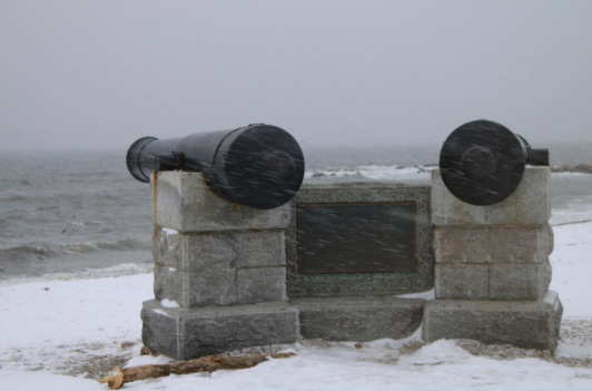 Cannons hold the fort facing the Long Island sound with strong winds at Compo.