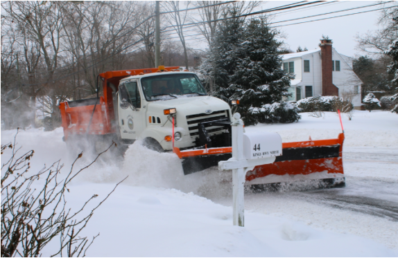 Snow plows fill the streets all day Tuesday in hopes of clearing the roads for safe driving.