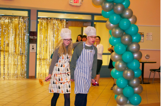 Sporting chefs attire, Lily Dane '17 and Austin Brulee '16 take the runway.