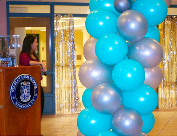 Best Buddies president Victoria Pappas '15 announces the runway stars.