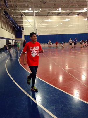 Luis Cruz '15 runs on the Staples indoor track during his off season to prepare for outdoor track and field.