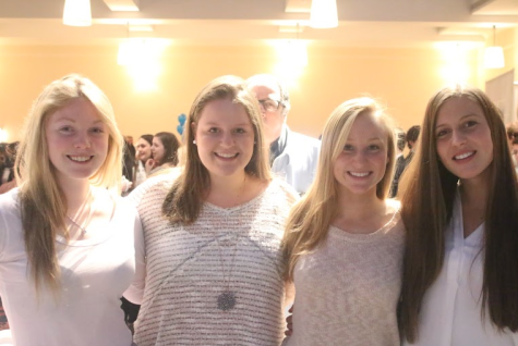 Maggie Walsh, Maggie Fair, Danielle Williams and Amelia Heisler '15 show support for their friends in the show.