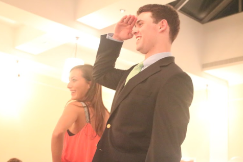 Slone Cooper and Teddy Coogan '15 please the crowd with a fun pose at the end of the catwalk.