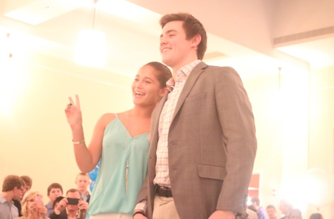 Long time friends Alexa Davis and Owen Burke are all smiles are the crowds of people and camera that surround them.