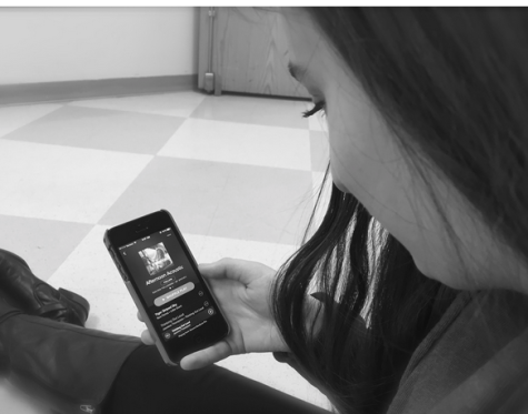 "Tuning In -- Melanie Orent '16 browses through Spotify's Afternoon Acoustic playlist and listens to Jasmine Thompson's acoustic version of ""Thinking Out Loud,"" originally sung by Ed Sheeran."