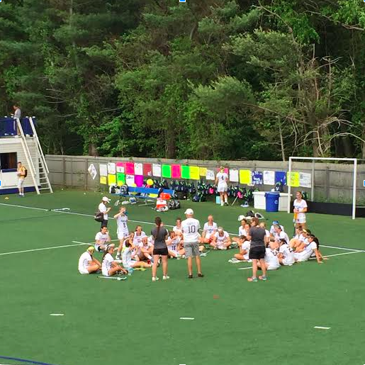 Staples listens to coach Pete Najarian during halftime of their FCIAC game against Wilton the previous week.