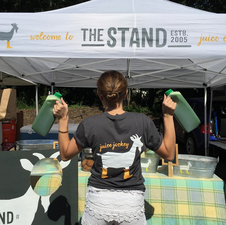 "Kowalsky holding ""The Stand(ard)"" green juice at the Westport Farmer's Market. 