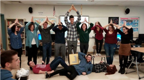 "At the club's annual Hanukkah celebration, students along with club advisor Fran Sinay are challenged to create a human menorah. In the middle stands Kyle Ratner '16. ""We couldn't have found a better Shamash than him,"" Kessler said. Photo contributed by Gaya Kessler."