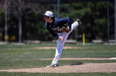 Chad Knight '18 delivers a pitch for the Wreckers.