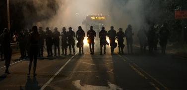 Police officers in Charlotte form a line to control the violent riots and protests