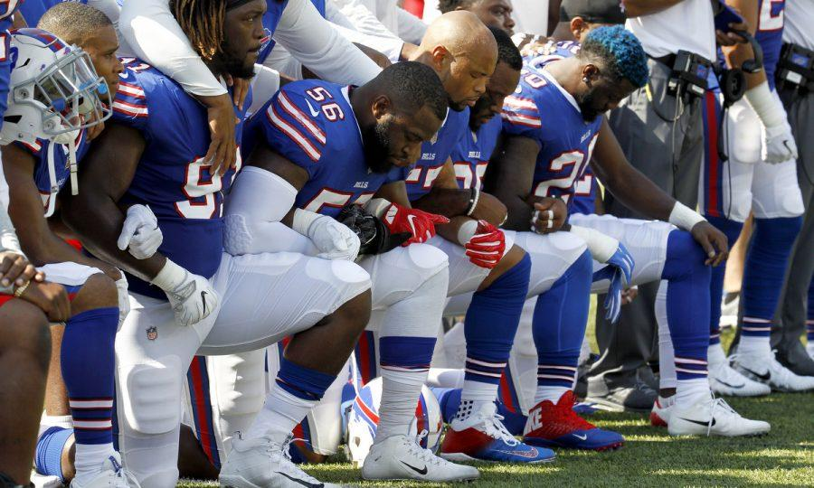 Buffalo+Bills+players+kneel+during+the+national+anthem+prior+to+an+NFL+football+game+against+the+Denver+Broncos%2C+Sunday%2C+Sept.+24%2C+2017%2C+in+Orchard+Park%2C+N.Y.+%28AP+Photo%2FJeffrey+T.+Barnes%29