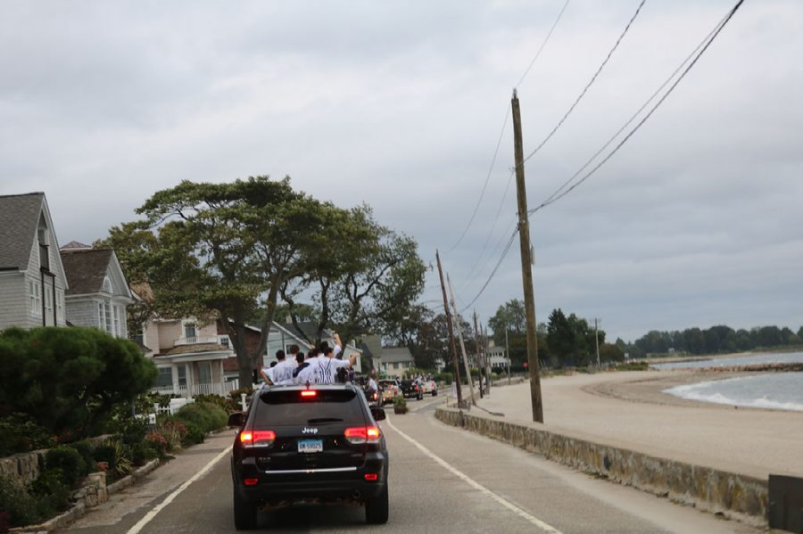 Motorcade unites class of 2019 in final ride to homecoming