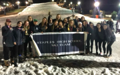 After placing second in the state tournament, the Staples girls' ski team poses at the bottom of Mount Southington following the awards ceremony.
