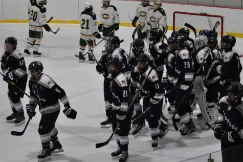 Staples boys' hockey defeats Trinity in overtime game