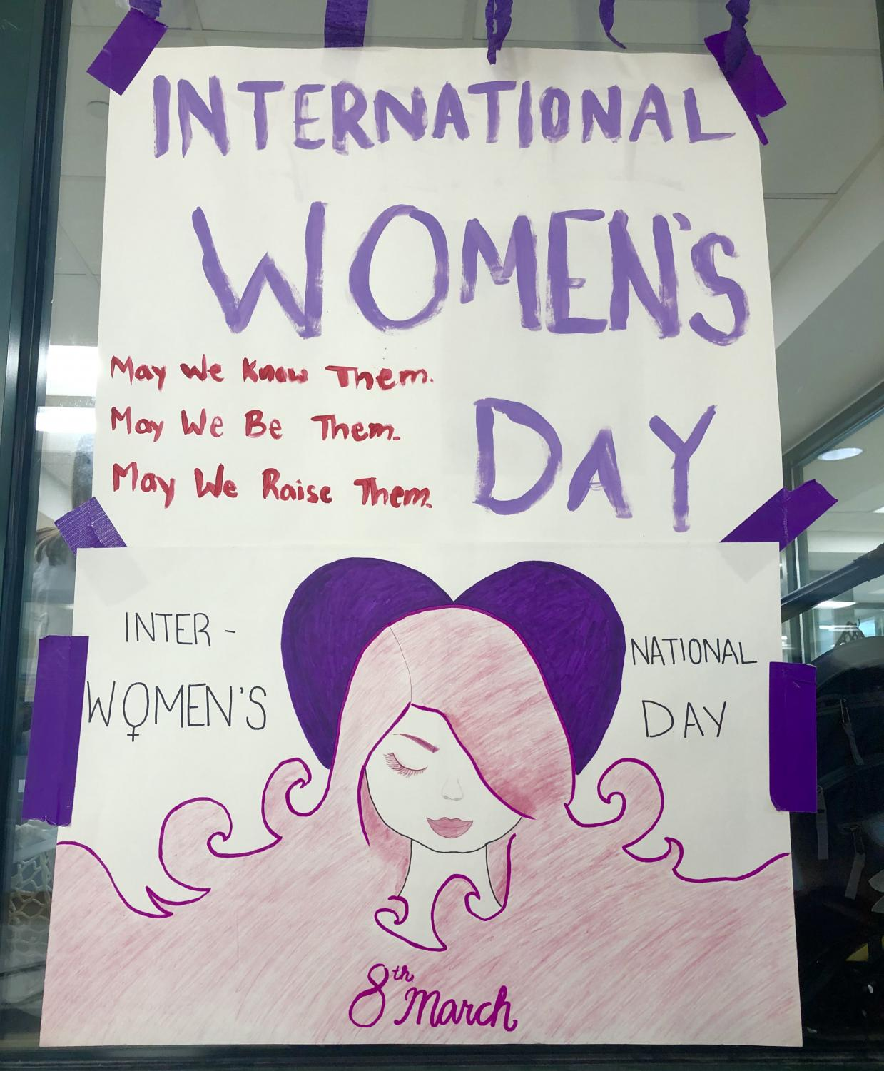 Students in Women in History encouraged their peers to partake in activities for International Women's Day, including wearing purple to school and answering various true or false questions.