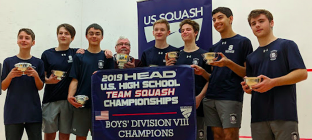 The Staples Boys' Squash Team poses with their trophies after being named national champions.