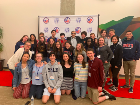 Staples' We The People class poses with John Tinker of the landmark Supreme Court case Tinker v Des Moines, which extended students' freedom of speech.