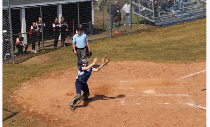 Jen Westphal '22 makes a play at home plate. She is one of three freshman on the Staples varsity softball team.