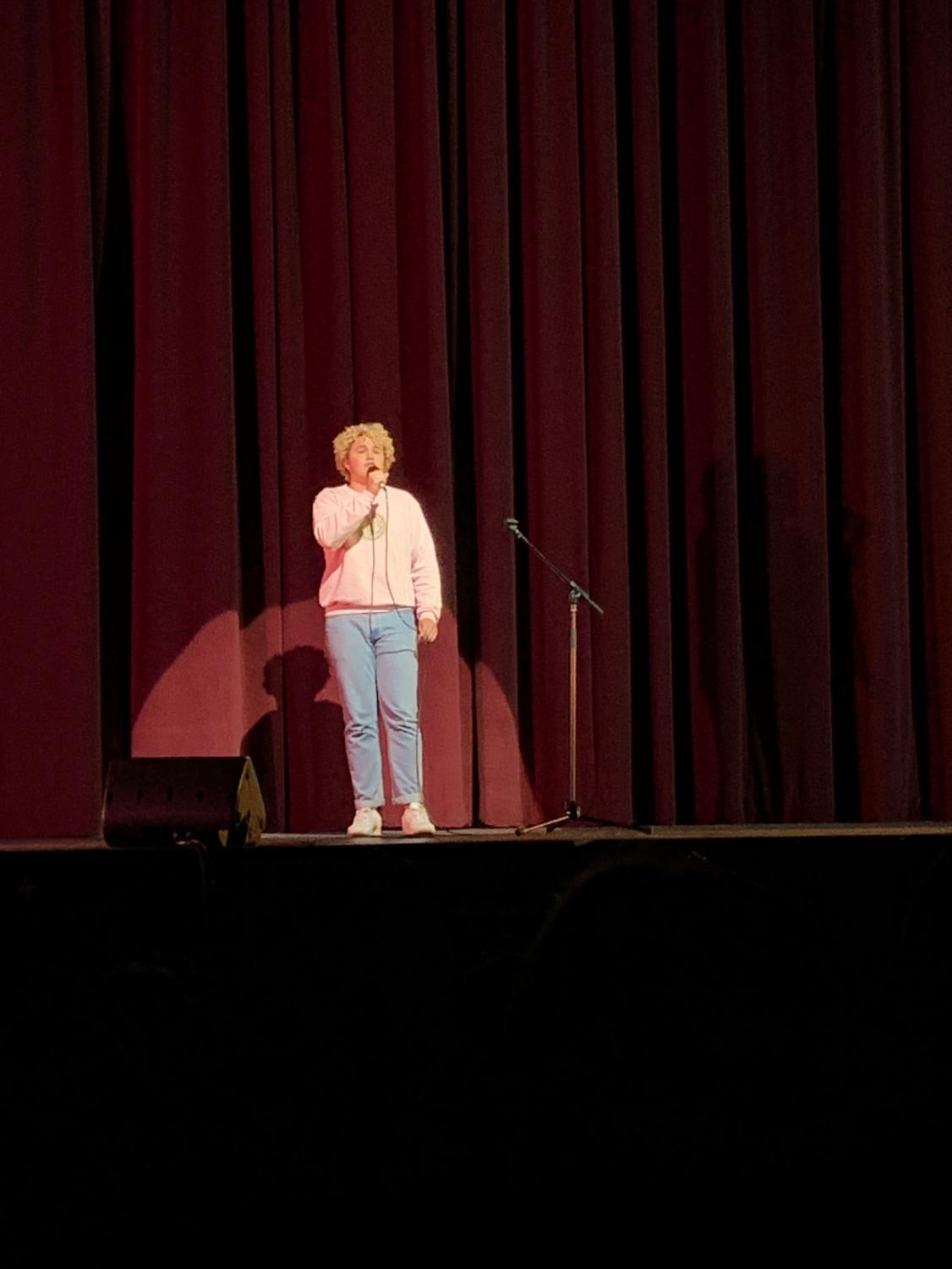 Ben Roland '19, a familiar face at the Variety Show, performs for the in front of the student-packed audience.