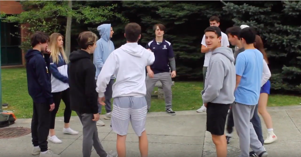 Students play hackey sack out in the courtyard with their friends during their free time.