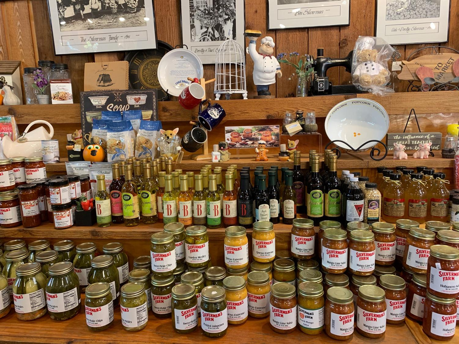 Different homemade condiments, fruits and pastries sold in the market at Silverman's Farm.