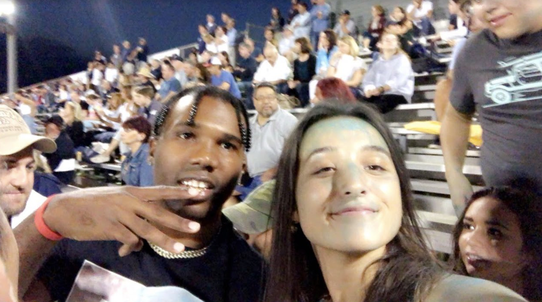 Yalee is a 25-year-old rapper, singer, songwriter and performer. Michelle Kaminski '21 poses with Yalee at the football game on Sept. 28