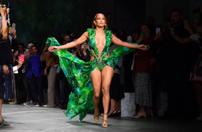 Jennifer Lopez walks in the Versace show wearing the same dress she wore 20 years ago that resulted in the creation of google images.