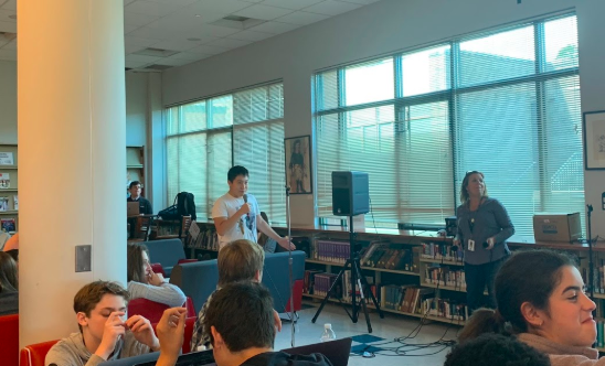 William Jin '23 sings 'September' by Earth, Wind & Fire during karaoke in the library.